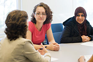 A student Consulting with a counselor